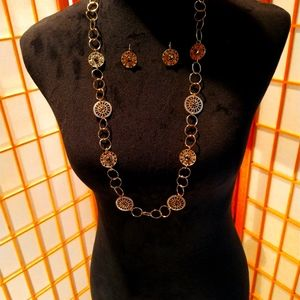 Long gold necklace with matching earrings